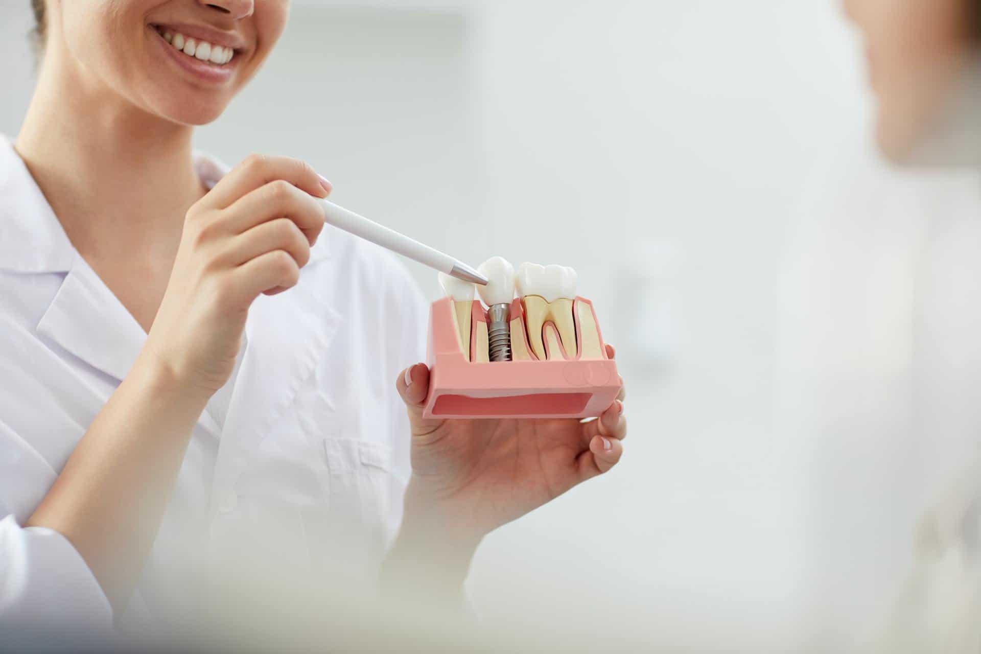 Smiling Dentist Explaining Tooth Implantation