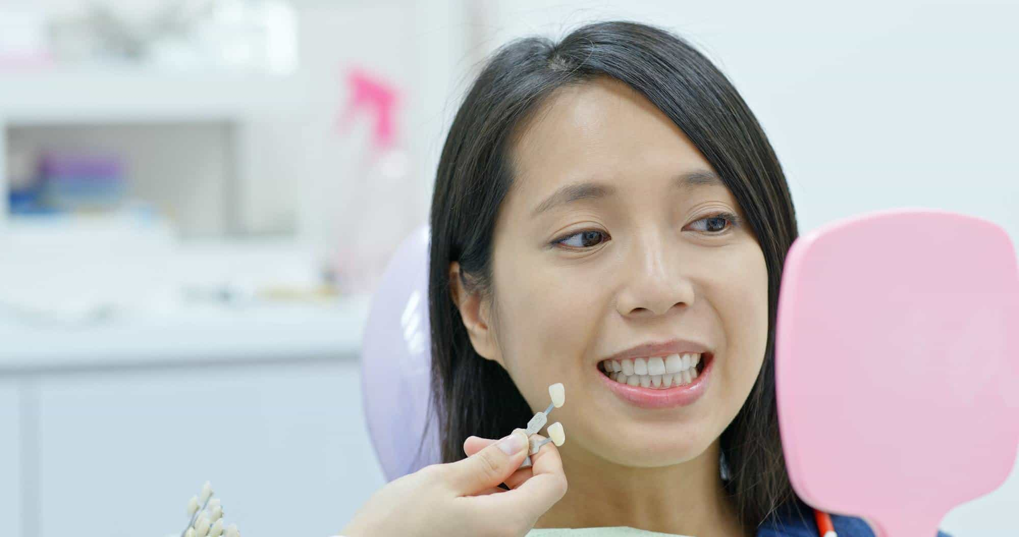 Woman go dental clinic for whitening teeth